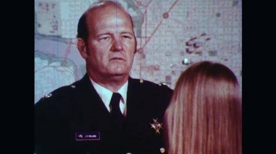 UNITED STATES: 1970s: man talks to teenagers.