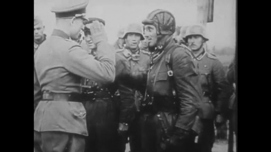 POLAND: 1960s: leaders speak with pilots. Soviet soldiers shake hands. Soldiers march through street