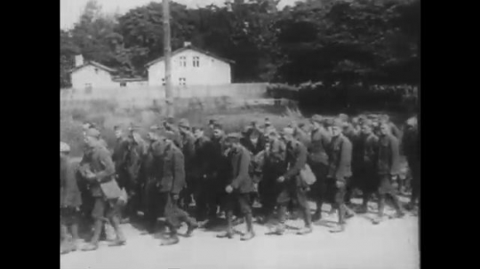POLAND: 1960s: soldiers file through streets. Prisoners of war line up in rows