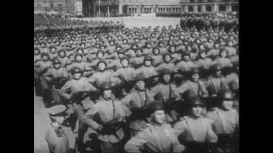POLAND: 1960s: soldiers march in street. Men parade in square. Men in uniform salute. Tanks in square.