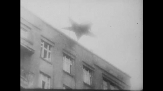 POLAND: 1960s: star fall from building. People burn flags