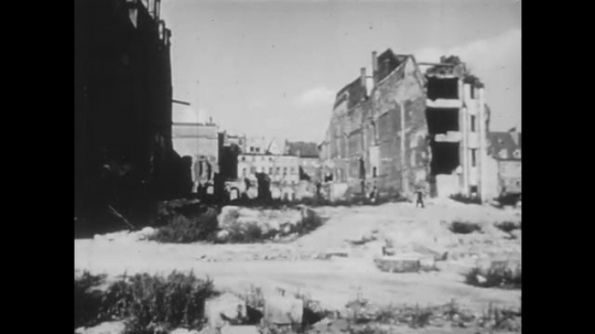 POLAND: 1960s: damaged buildings after bombing. Man in meeting