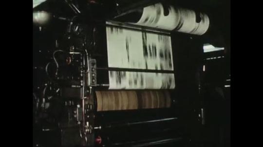 UNITED STATES: 1950s: newspaper on printing press machine. Machine sorts books. Map of world. Letter and invitation.