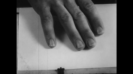 1950s: UNITED STATES: hand make stab marks with knife in packing.