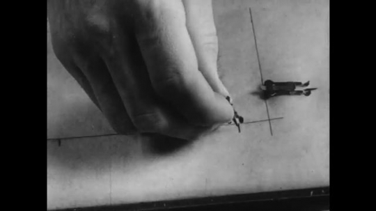 1950s: UNITED STATES: hands put gage pins in place on press. Hands stab sheet.