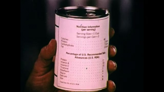 UNITED STATES: 1970s: close up of nutritional information on back of tin of food