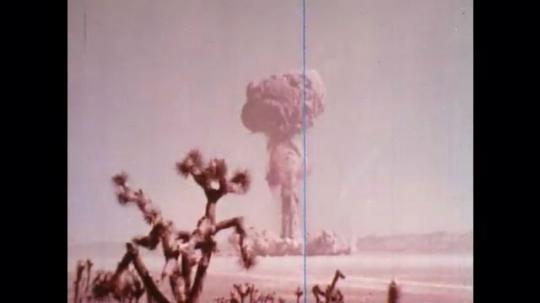 UNITED STATES: 1960s: mushroom cloud above desert.