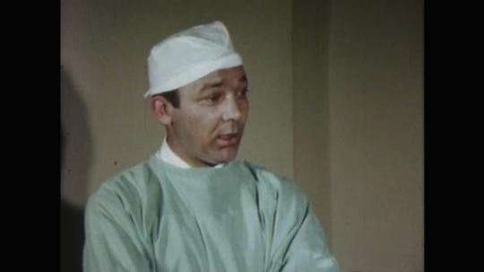 UNITED STATES: 1960s: medic speaks at hospital