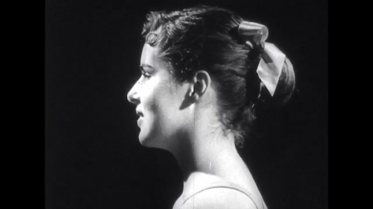 UNITED STATES: 1950s: girl leans forward in side profile. X-ray of head moving.