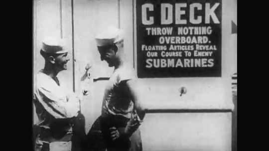 UNITED STATES: 1910s: sailors laugh together on C Deck of military ship. Soldiers play games on deck of ship. Sailors have sack race on ship deck. Soldiers have pillow fight on pole.