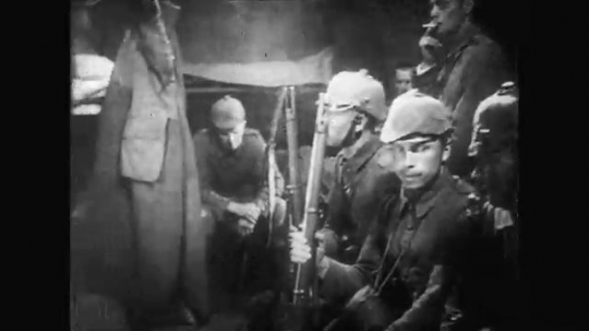 UNITED STATES: 1910s: soldiers sit and smoke. Soldiers rest. Soldiers walk through trenches.