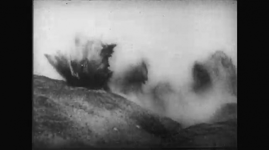 UNITED STATES: 1910s: gun fire. Soldier dead after hit. Soldiers in trench during attack.