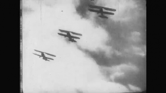 UNITED STATES: 1910s: military planes in sky. Pilot in plane.
