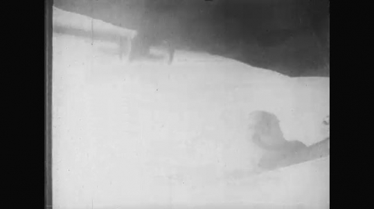 UNITED STATES: 1910s: pilot in military plane in sky. Gunner in plane. Gunner fires weapons at planes.