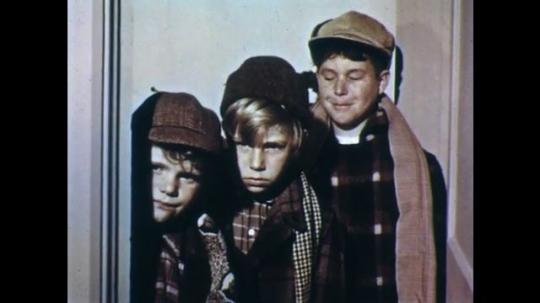 UNITED STATES: 1950s: three boys in doorway. Bedroom at night. Boys sleep.