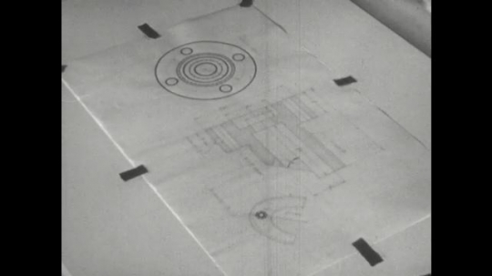 UNITED STATES: 1960s: hand draws circles with compass on tracing paper. Fingers draw around shape.