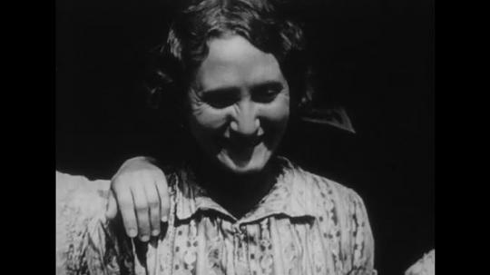 UNITED STATES: 1950s: ladies smile. Man looks sad. Man talks to camera