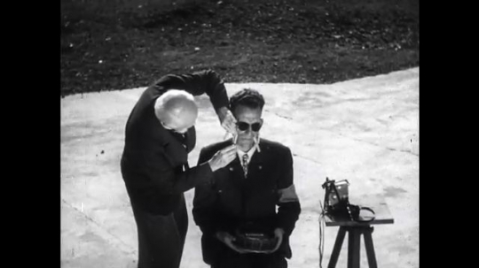 UNITED STATES: 1940s: psychologist inflicts pain on blind man. Man senses object