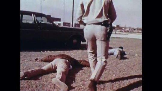 UNITED STATES: 1970s: police officer recruits learn to make arrests of armed criminals