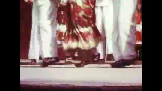 UNITED STATES: 1960s: ladies and men dance. Traditional dancing. Girl plays outside at festival