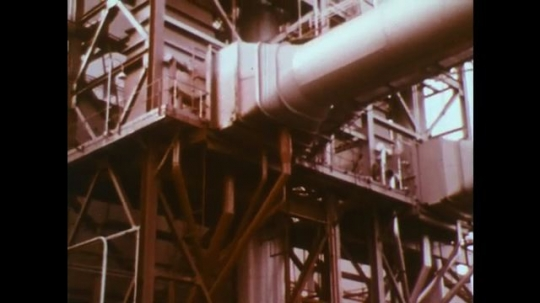 UNITED STATES: 1950s: industrial structure of processing plant. Crane over water