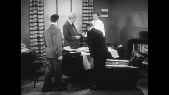 1950s: Men sit down in office. Man talking. Man talking. Man nods.