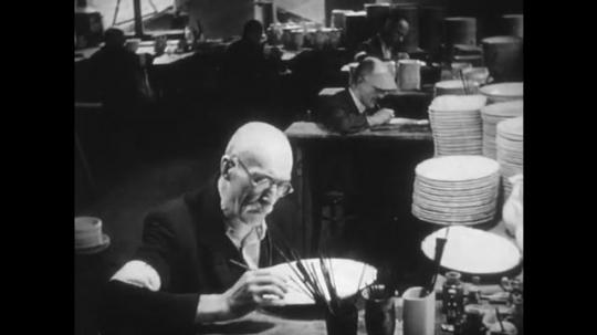 1950s: Man paints china. Man herding sheep. Man feeds hogs. Man cleans butchered hog. Man presses button.