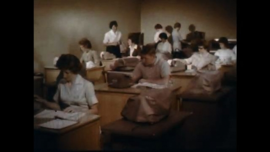 1960s: men and women type on adding machines in classroom . woman monitors woman on adding machine. women in laboratory. woman scrapes object in laboratory classroom. woman smiles in dentist office.