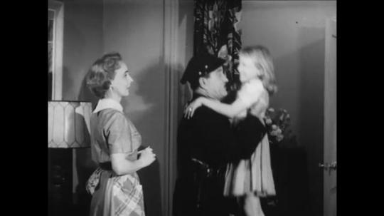 1950s: Little girl runs into police officer