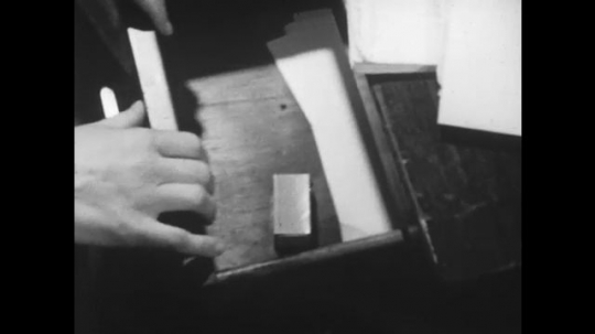 1950s: UNITED STATES: Hands open drawer. Hands take pills from drawer. Lady takes water from cooler. Lady swallows pills