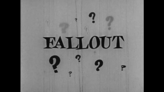 1950s: UNITED STATES: Animated title 'fallout'. Rain falls on title. Cartoon man watches projector. Man hides face in fear. Man smiles