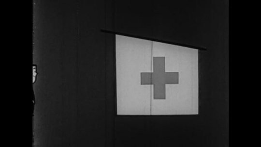1950s: UNITED STATES: animation of first aid cross. Man leaves house. Man brings supplies to house