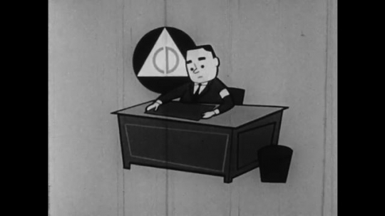 1950s: UNITED STATES: civil defense worker. Men in office. Cartoon characters look at plans for shelter
