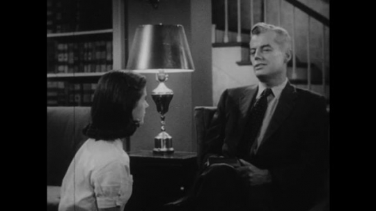 1950s: UNITED STATES: father answers daughter