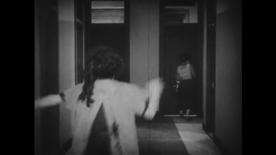1920s: women run down hallway and exit through doors. lion jumps up on transom and roars at men and women in office. woman grabs lion tail and exits. woman slids across floor. lion leaps around room.