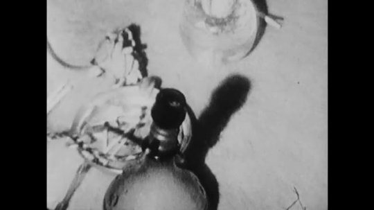 1960s: Hookah on floor, zoom out to people smoking.