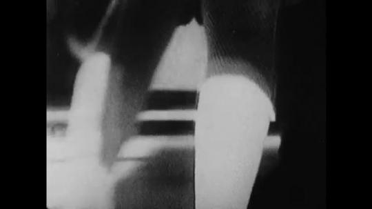 1960s: View of feet. Legs dancing. Couples dancing.