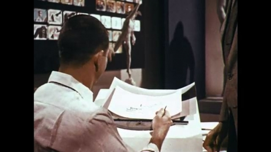 1960s: man at desk shows drawing of hand touching object. animated character touches inside of finger and signals with telegraph machine. electrical charge travels up arm to brain.