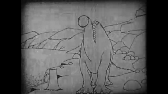 1910s: Animation, dinosaur eats tree stump, stamps feet, wooly mammoth enters.