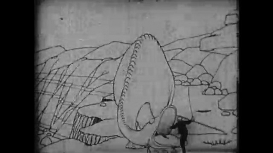 1910s: Animation, dinosaur lifts man on to back, walks off screen. Intertitle.