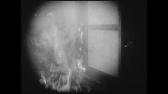 1910s: Schoolgirl saves an unconscious girl from burning building. Fire engine rushes to the scene.