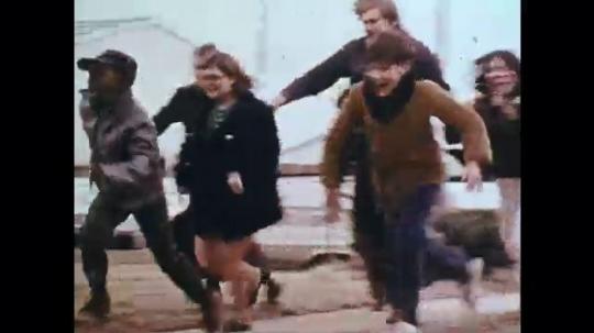 1970s: UNITED STATES: children run to house. Children visit fair in building