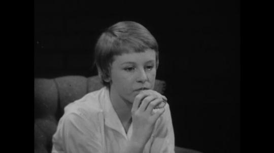 1950s: Girl eats cookie. Boy