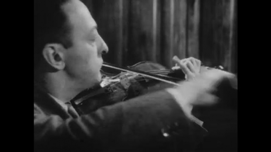 1950s: UNITED STATES: musician performs piece on violin instrument