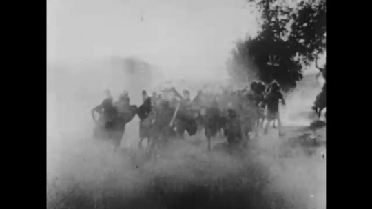 1910s: UNITED STATES: Soldiers follow horse and cart in battle. Man rides on chariot. People fight by well. Men with swords