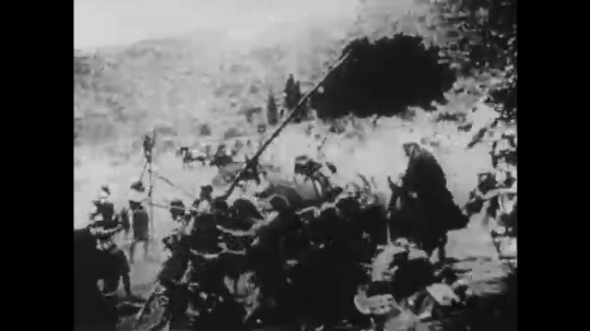 1910s: UNITED STATES: men fight in battle. Lady looks up to sky. Soldiers fire bows. Horse hit by arrow