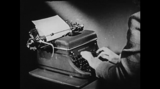 1940s: UNITED STATES: hands type on typewriter. Finger dials numbers on telephone. Hand inputs numbers on calculator