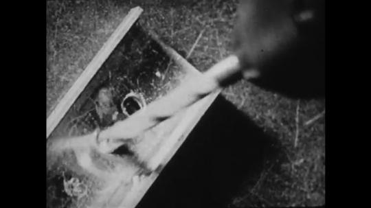 1940s: UNITED STATES: drill makes hole . Stamp machine. Hand lifts telephone receiver. Typewriter keys jam.