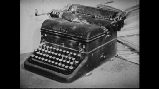 1940s: UNITED STATES: dusty typewriter. Lady types on typewriter. Lady opens desk drawer. Lady puts cover on typewriter