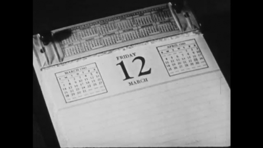 1940s: UNITED STATES: pages turn in calendar. Pen crosses off dates on calendar